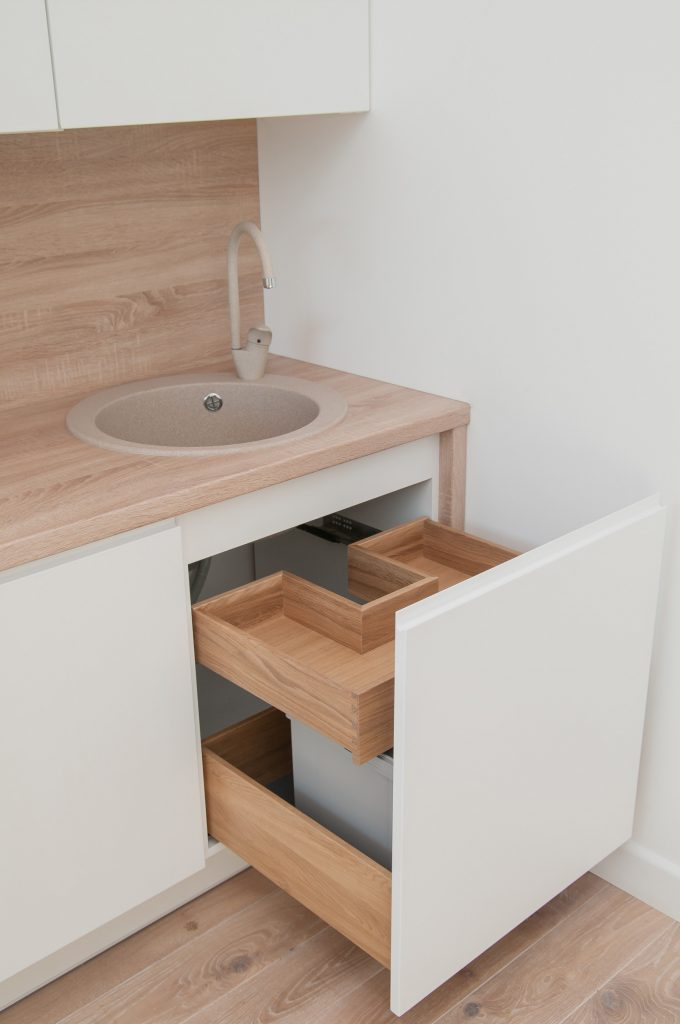 Drawers under the sink in the kitchen